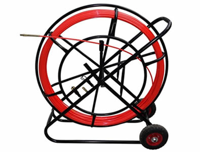 A duct rodder with red rubber wheel, red pulling rod, a hand brake on the carrier, also with duct rod grapples set and a drawing head.